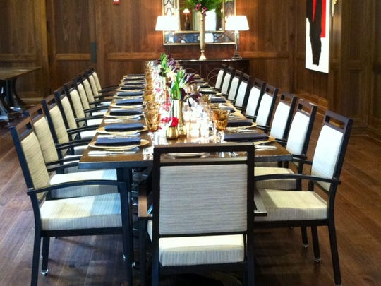 The room's centerpiece is a custom-made solid wood