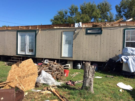 A mobile home in Holiday Beach was damaged by a tornado on March 29, 2018.
