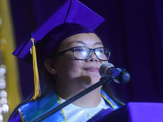 Salutatorian Alyssa Bersamin, 18, delivers a speech during the George Washington High School Class of 2018 Graduation Exercise at the University of Guam Calvo Field House on June 1, 2018.