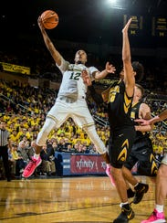 Michigan's Muhammad-Ali Abdur-Rahkman shoots against