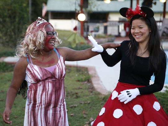 Destinee Germany, left, and Julia Kadzis play fight with each other during a Halloween party hosted by a parent of a student from the Florida School for the Deaf and Blind, where the two girls met.