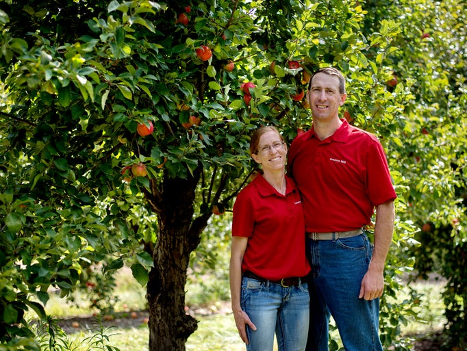 Country Mill Farms owner Steve Tennes, right, and his