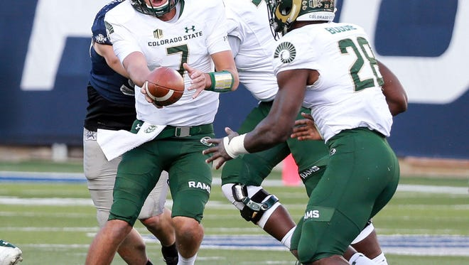 Oct 7, 2017; Logan, UT, USA; Colorado State Rams quarterback Nick Stevens (7) hands the ball off to Colorado State Rams running back Rashaad Boddie (28) during the second half against the Utah State Aggies at Merlin Olsen Field at Maverik Stadium. Colorado State Rams won the game 27-14. Mandatory Credit: Chris Nicoll-USA TODAY Sports