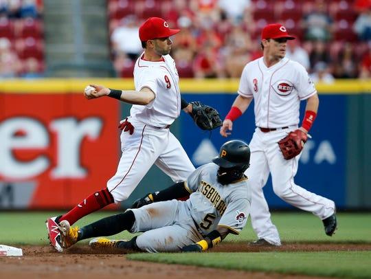 Cincinnati Reds second baseman Jose Peraza (9) gets