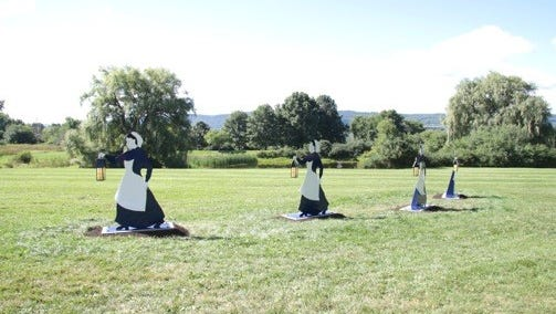These four figures, created by local artist Rob Licht,  make up a monument to the women who went as nurses during the Civil War.
