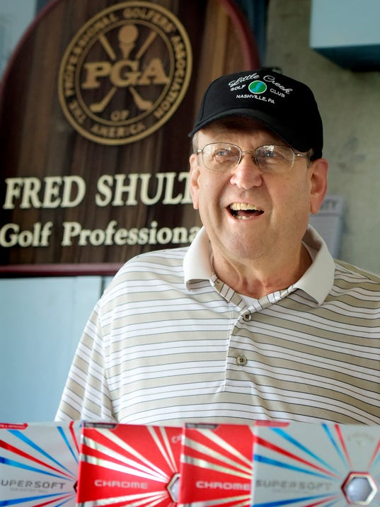 Golf Pro Fred Shultz sits stands by a custom sign Wednesday, August 19, 2015, at the pro shop at Little Creek Golf Course which he is revitalizing. He has been involved in golf for 40 years in York County.  He is recovering from two strokes he suffered in September. Bill Kalina - bkalina@yorkdispatch.com