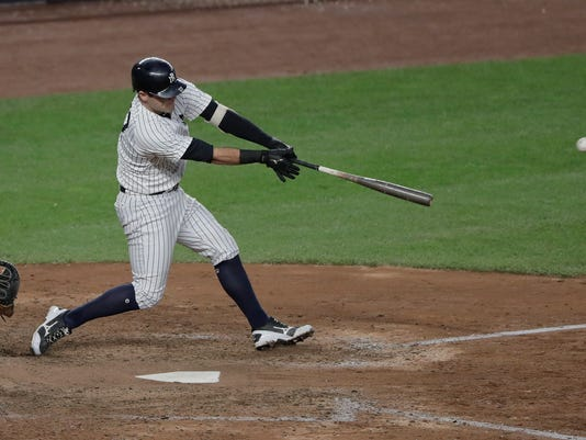 New York Yankees' Austin Romine connects for a base hit to drive in two runs against the Baltimore Orioles during the eighth inning of a baseball game, Saturday, Oct. 1, 2016, in New York. The Yankees won 7-3. (AP Photo/Julie Jacobson)