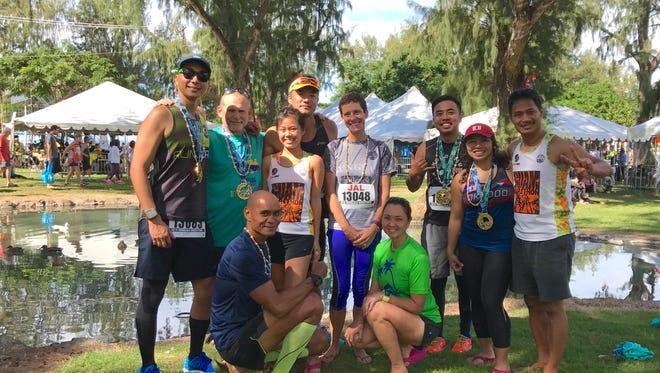Several runners from Guam ran the Honolulu Marathon on Dec. 11. Top row from left: Josh Tyquiengco, Steve Wolborsky, Dianne Sapida, Hidefumi Iseki, MJ Wolborsky, Kenneth Pascual, Michelle Franquez, Manny Hechanova. Bottom row from left: Leo Tkel and Yuka Hechanova.