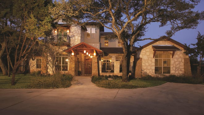 A romantic balcony and gated walkway add curb appeal.