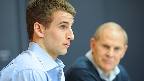 Austin Hatch and John Beilein meet with reporters Monday at the Crisler Center.