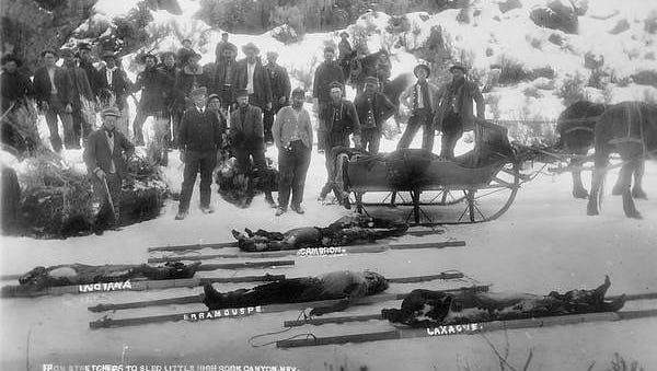 The bodies of the slain Basque sheepherders on sleds for removal from Little High Rock Canyon in February 1911 where they were killed.