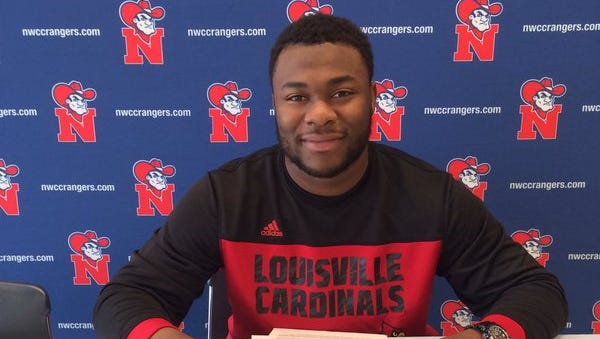Northwest Mississippi Community College defensive lineman Chris Williams signs with Louisville on Dec. 16, 2015
