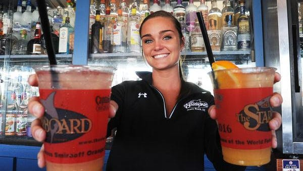 Eileen Marge from Wilmington makes Orange and Grapefruit Crushes with fresh fruit at the Starboard in Dewey Beach.