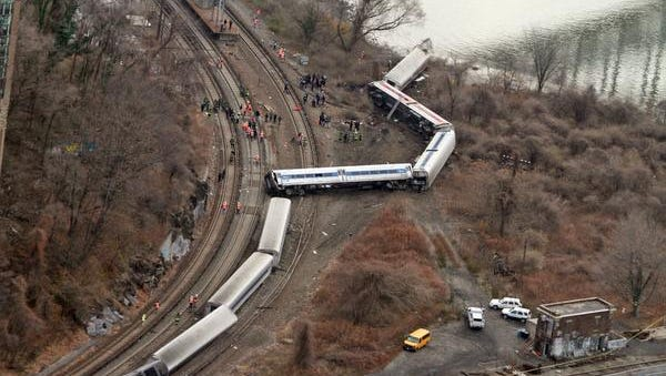 Emergency personnel work at the scene of a Metro-North train that derailed just north of the Spuyten Duyvil station in the Bronx Dec. 1, 2013. Four people were killed and dozens more were injured when the Manhattan bound train derailed shortly after 7:00 a.m.