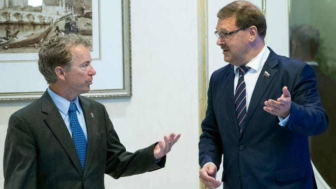 Sen. Rand Paul, left, speaks with Chairman of the Russian Federation Council Committee on International Affairs Konstantin Kosachev during their meeting in Moscow, Russia, Monday, Aug. 6, 2018. Paul said he invited Russian lawmakers to visit the United States to help foster inter-parliamentary contacts.