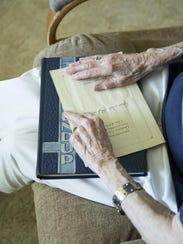 Gertrude Severson Hart holds a copy on her lap of the