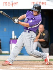 BC Merchants Beau Langs takes a swing during early action in the NABF World Series.