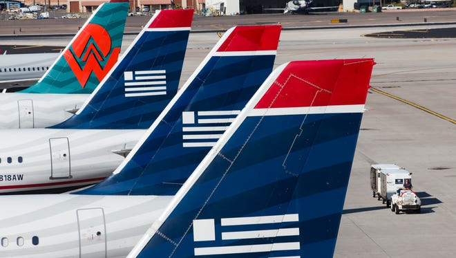 US Airways planes, including painted with a retro America West logo, at Phoenix Sky Harbor Airport on Feb. 13, 2013.