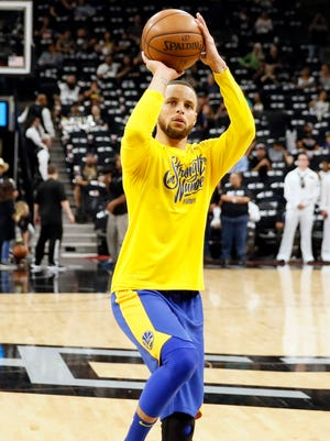 Golden State Warriors point guard Stephen Curry warms up prior to Game 3 of the first round.