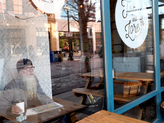 Michael Provard looks out the window at Trade and Lore