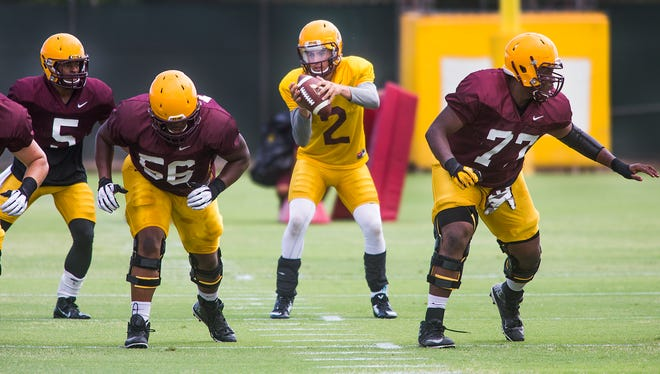 Quarterback Mike Bercovici takes the shotgun snap at the Arizona State University football practice in Tempe, Friday, Aug. 22, 2014.