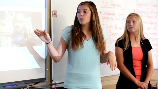 Parkview sophomores Alyson Revie, left, and Michaela Oesterreich make a presentation with her team as part of the school's Leadership School on Tuesday, Sept. 30, 2015