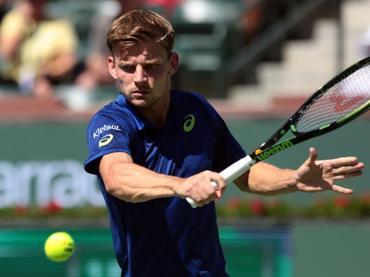 David Goffin of Belgium returns the ball to Stan Wawrinka of Switzerland on Wednesday, March 16, 2016 at the Men's 4th round at the BNP Paribas Open.