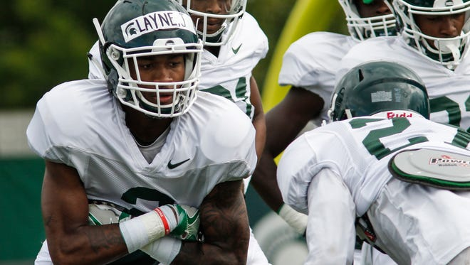 MSU CB/WR Justin Layne works drills during football practice Friday, August 4, 2017.  [MATTHEW DAE SMITH/Lansing State Journal]