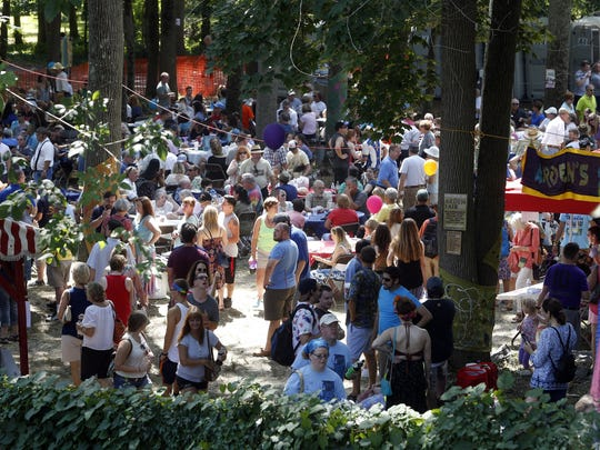 Sunlight filters into the Shady Grove -- a beer and music garden -- during an Arden Fair.