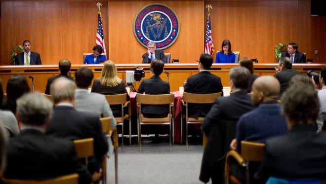 Federal Communication Commission  Chairman Tom Wheeler, center, and other FCC commissioners during a hearing and vote on net neutrality in Washington, D.C., Feb. 26, 2015.