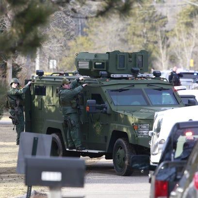Numerous law enforcement vehicles and SWAT teams respond
