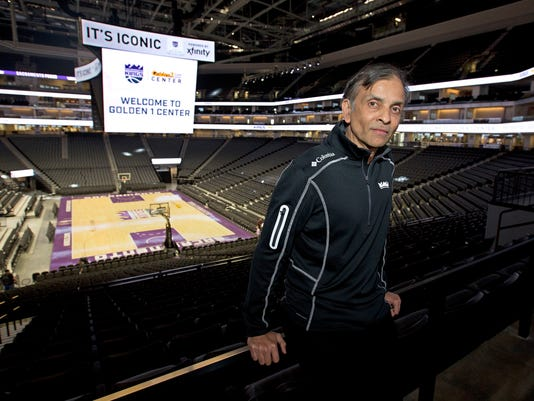 FILE - In this Sept. 27, 2016, file photo, Vivek Ranadive, the majority owner of the Sacramento Kings, poses in the new Golden 1 Center in Sacramento, Calif. The Kings are expected to bid on hosting the 2022 or 2023 NBA All-Star Game. (AP Photo/Rich Pedroncelli, file)