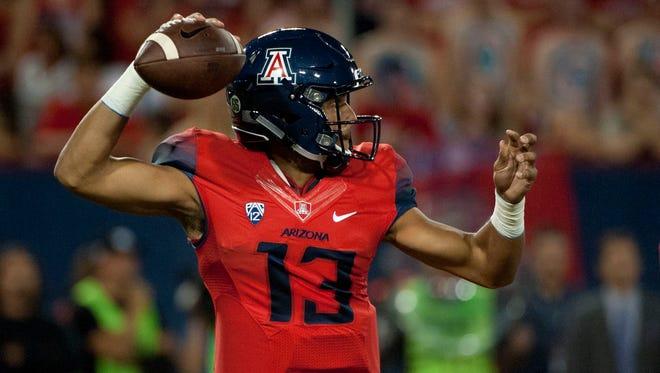 Oct 29, 2016; Tucson, AZ, USA; Wildcats quarterback Brandon Dawkins (13) passes the ball against Stanford during the second quarter.