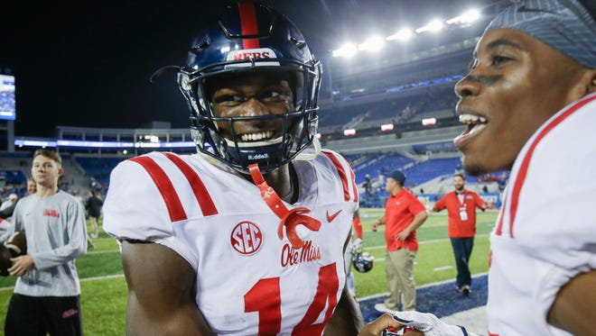 D.K. Metcalf (14) celebrates his touchdown reception with five seconds left, which won Ole Miss the game against Kentucky.