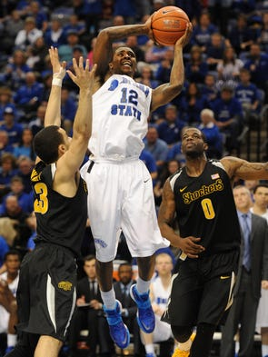 Indiana State's Dawon Cummings drives to the basket against Wichita State's Fred Van Vleet, 23, and Chadrack Lufile, 0, in the second half,  as the Indiana State Sycamores hosted the Wichita State Shockers at the Hulman Center at Indiana State University in Terre Haute, Ind., Wednesday February 5, 2014.
