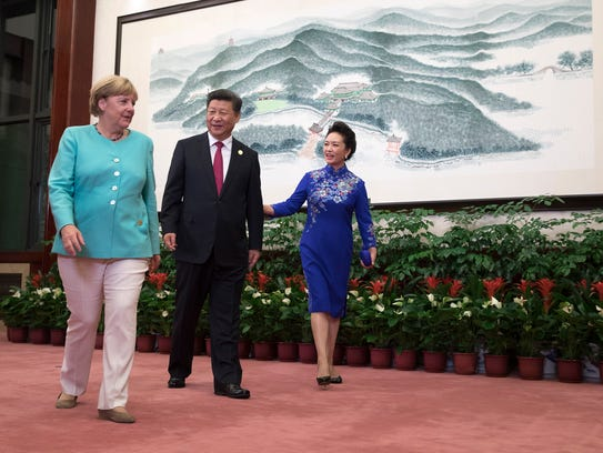 Chinese President Xi Jinping greets German Chancellor