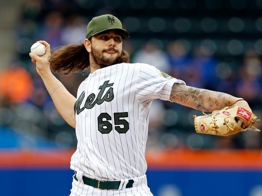 Mets starting pitcher Robert Gsellman (65) pitches against the Milwaukee Brewers during the first inning at Citi Field.