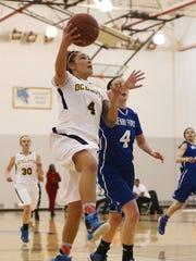Schoolcraft's Rikki Sherdt (left) goes up for a layup Saturday against Henry Ford defender Mariah Anderson.