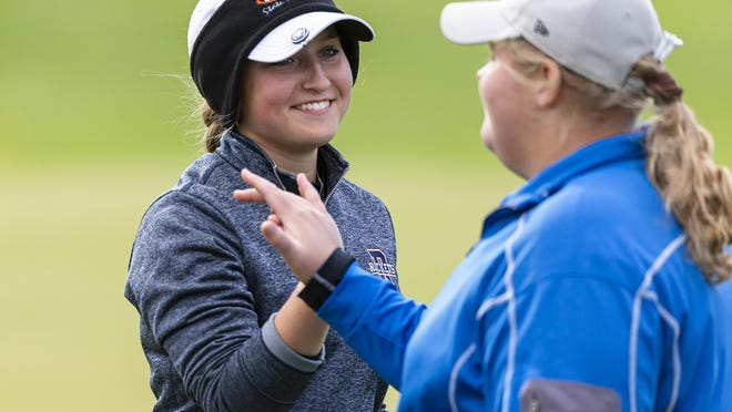 Rochester's Karlie Schnepp gets a high five from Williamsville's Faith Davis after she sunk a birdie putt to defeat Davis and Sacred Heart-Griffin's Sofie Lowis in the first playoff hole to win the Class 1A Rochester Sectional at the The Rail Golf Course, Thursday, October 15, 2020, in Springfield.
