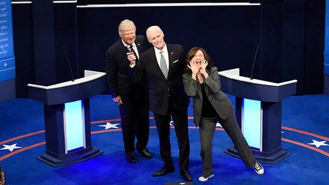 "Alec Baldwin as Donald Trump,left, Jim Carrey as Joe Biden, and Maya Rudolph as Kamala Harris during the ""First Debate"" cold open on ""Saturday Night Live"" in New York on Saturday."