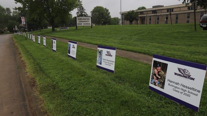Signs for Burlington High School Class of 2020 graduating seniors line the road around the school May 22 in Burlington.
