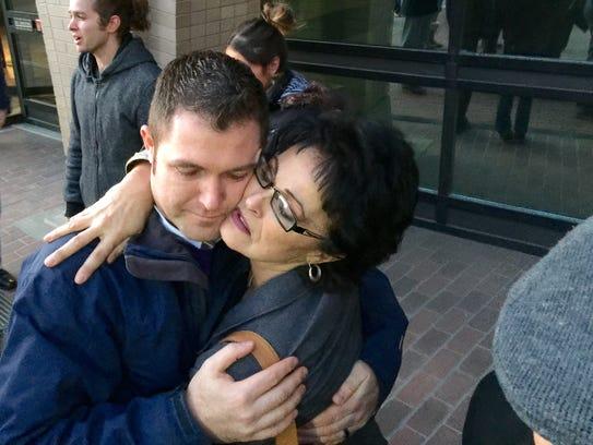 Rhonda Firestack-Harvey hugs her son, Rolland Gregg,