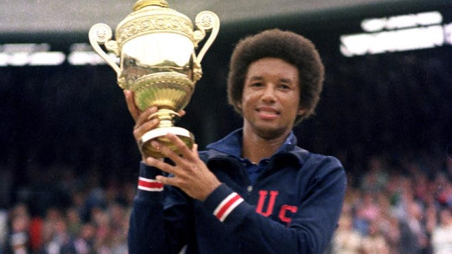 FILE - In this July 5, 1975 file photo, Arthur Ashe holds his Wimbledon trophy cup after defeating fellow American Jimmy Connors in the final match of the men's singles championship at the All England Lawn Tennis Championship at Wimbledon in London.