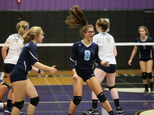 Westlake's Sydney Roell celebrates a point against