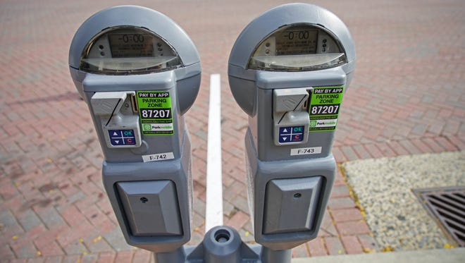 Drivers in downtown Wilmington can now pay for parking with their phones using a Parkmobile appÊat approximately 1,000 metered spaces in the downtown district. It will allow drivers to add money to the meter remotely