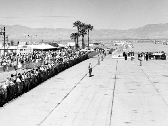 Crowd at the Palm Springs airport waiting for President John F. Kennedy to arrive.