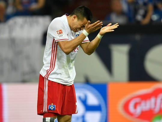FILE - In this May 13, 2017 file photo, Hamburg's Bobby Wood reacts after he missed to score during the German Bundesliga soccer match between FC Schalke 04 and Hamburger SV in Gelsenkirchen, Germany. The clock is ticking on Hamburger SV's days in the Bundesliga. Situated high in the stadium, the clock counts the years, days, hours, minutes and seconds that Hamburg has been playing in the league. In recent years, however, it seems as though the clock should be ticking down. Hamburg has been flirting with relegation and this season is the club's worst yet. (AP Photo/Martin Meissner,file)
