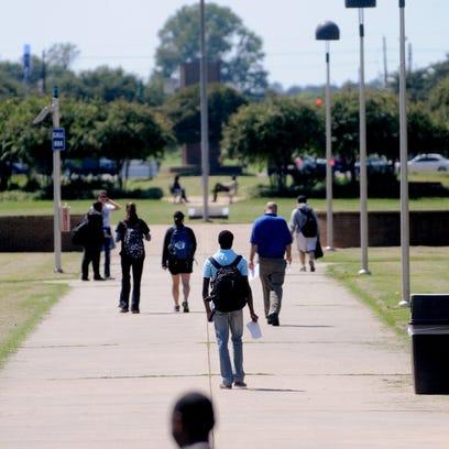 Students walk across the LSUS campus in Shreveport.