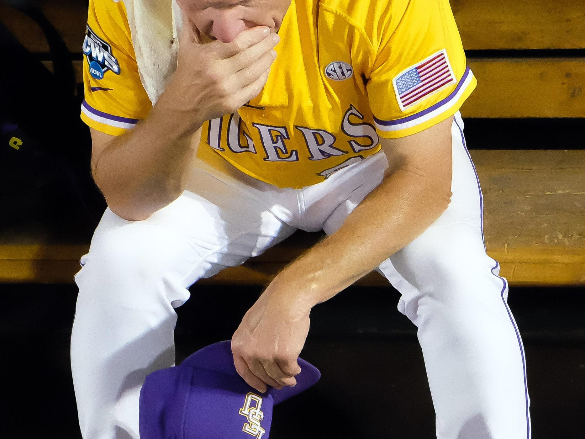 Jun 18, 2015; Omaha, NE, USA; LSU Tigers assistant coach Alan Dunn sits in the dugout after the loss against the TCU Horned Frogs in the 2015 College World Series at TD Ameritrade Park. TCU defeated LSU 8-4. Mandatory Credit: Steven Branscombe-USA TODAY Sports