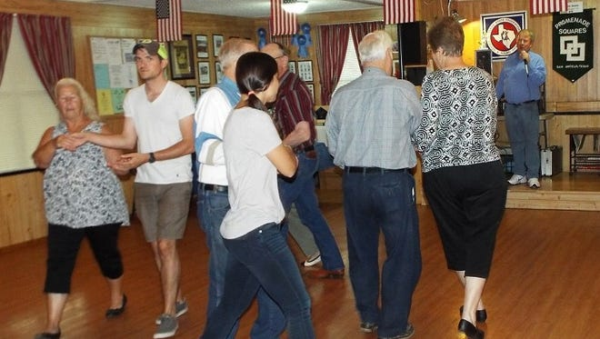 The Promenade Squares dance club recently entertained visitors from New York City. Facing camera at left is Justin Hicks of Brooklyn and, nearest camera, Alex Warren of Harlem. They are in San Angelo on an employment-related mission.